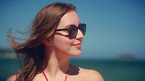 Close up portrait of european beautiful cute brunette young woman or cheerful girl smiling looking at camera, running stock video