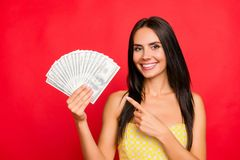 Close up portrait of excited beautiful gorgeous attractive pretty cheerful confident dark-haired woman demonstrating fan made stock photo