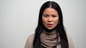 Close up portrait of extremely angry woman. Close-Up Of Outraged Asian Woman Who Loses Her Temper. Felling Angry, The Irritated Woman Goes Away stock video