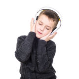Close up portrait of eyes closed boy listening to music with hea Royalty Free Stock Image