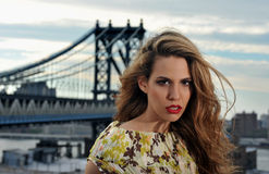 Close up portrait of fashion model with full sexy hair and red lips posing on rooftop location Royalty Free Stock Photography