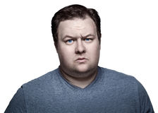 Close up portrait of fat man in studio sceptical. Isolated on white background. royalty free stock photography