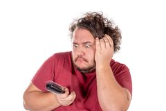 Close up portrait of fat man tries to comb his tangled and naughty hair with a small black comb isolated on white background. Close up portrait of fat man tries royalty free stock photos