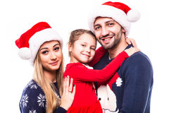 Close up portrait of father, mother and daugher on Christmas holiday. Stock Photos