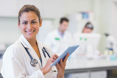 Close up portrait of a female doctor with tablet PC Royalty Free Stock Photos