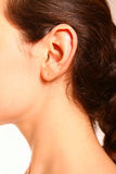 A close-up portrait of a female ear and neck Stock Photo