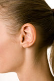 A close-up portrait of a female ear and neck Royalty Free Stock Image