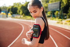 Close up portrait of a female runner using mobile phone Stock Photos
