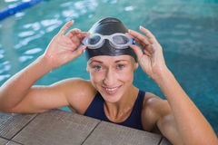 Close up portrait of female swimmer in pool at leisure center Royalty Free Stock Photo