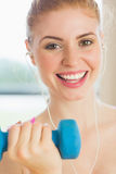 Close up portrait of a fit woman exercising with dumbbells Stock Photography