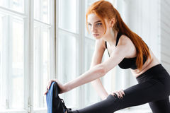 Close-up portrait of a fitness girl doing stretching exercises Royalty Free Stock Photography