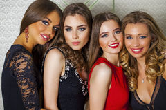 Close up portrait of four beautiful glamorous models in studio Royalty Free Stock Photo