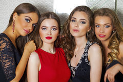Close up portrait of four beautiful glamorous models in studio Royalty Free Stock Photos