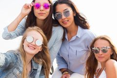 Close-up portrait of four beautiful young student girl royalty free stock photography