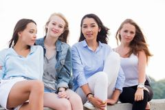 Close-up portrait of four young women in nature, selective focus stock photos