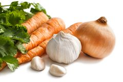 Fresh raw garlic, onion, and carrot. Close up portrait of fresh raw garlic, onion, and carrot isolated on white background Royalty Free Stock Photo