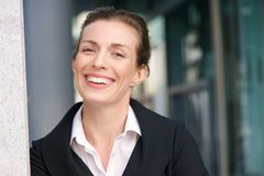 Close up portrait of a friendly business woman smiling Stock Images