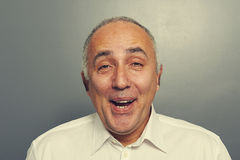 Close up portrait of funny laughing man Stock Photography