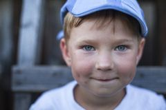 Close-up portrait of a funny little boy. Stock Photo
