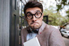 Close-up portrait of a funny nerd man wearing eyeglasses Stock Photography
