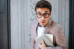 Close-up portrait of a funny nerd man wearing eyeglasses Stock Images
