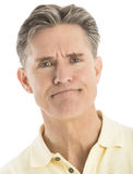 Close-Up Portrait Of Furious Man. Close-up portrait of furious mature man isolated over white background Royalty Free Stock Photography