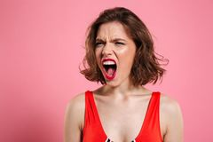 Close up portrait of a furious pretty woman Royalty Free Stock Photography