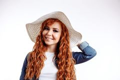 Redhead woman wearing hat on white background royalty free stock photos
