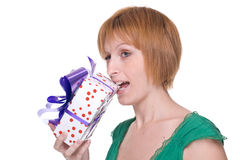 Close up portrait of girl that bite a gift Royalty Free Stock Image