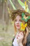 Close up portrait of a girl in a circlet of flowers Stock Image