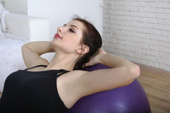Close-up portrait of a girl doing abdominal muscles Royalty Free Stock Image