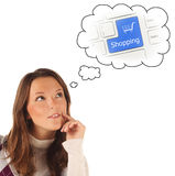 Close-up portrait of girl dreaming about on-line shopping (isola Royalty Free Stock Photography