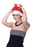 Close up portrait of girl in dress and santa hat Stock Photography