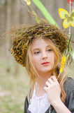 Close up portrait of a girl in a folk circlet of flowers Royalty Free Stock Photo