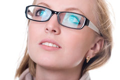 Close-up portrait of a girl with glasses facing upward.  Stock Photos