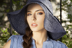 Close-up portrait of girl in the hat. Close-up portrait of an attractive girl in the hat, outdoors Royalty Free Stock Image
