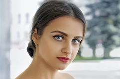 Close-up portrait of a girl with perfect clean skin. Against a light background Stock Image