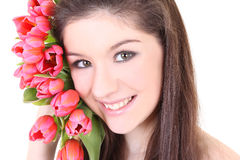 Close-up portrait of girl with pink tulips. Over white Stock Photo