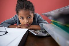 Close up portrait of girl pretending as businesswoman leaning on desk Stock Photo