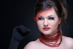 Close up portrait of girl with red lips and beads Stock Photography