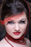 Close up portrait of girl with red lips and beads Stock Photo