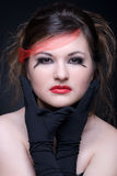 Close up portrait of girl with red lips on black Stock Photo