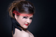 Close up portrait of girl with red lips on black Royalty Free Stock Image