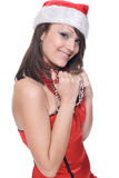 Close up portrait of girl in santa dress and beads Stock Photo