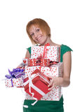 Close up portrait of girl with some gifts. Close up portrait of emotional girl in green dress with some gifts Royalty Free Stock Images