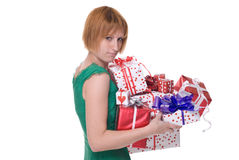 Close up portrait of girl with some gifts. Close up portrait of emotional girl in green dress with some gifts Stock Photos