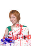Close up portrait of girl with some gifts. Close up portrait of emotional girl in green dress with some gifts Royalty Free Stock Photo