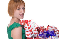 Close up portrait of girl with some gifts in mouth. Close up portrait of emotional girl in green dress with some gifts in mouth Stock Photography