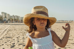 Close up portrait girl wearing wicker hat in summer. Beach background. royalty free stock photography