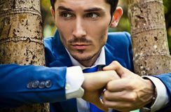 Close-up portrait of a good looking beautiful young man in costume outdoors. Stock Image